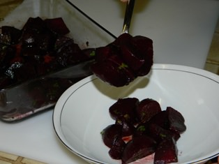 Serving roasted beets with balsamic vinegar.