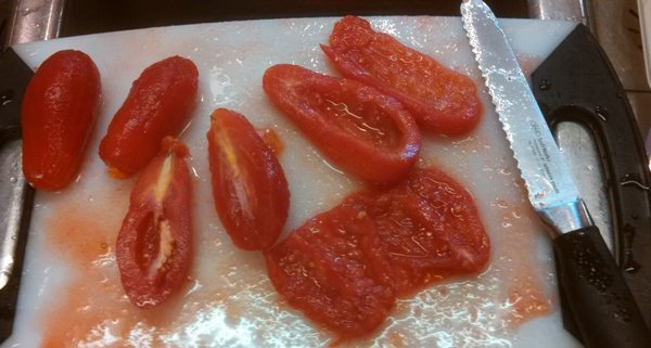 Preparing San Marzano Tomatoes to make puree.