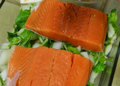 Salmon and bok choy before microwave steaming.