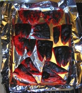Roasted Red Peppers ready to peel the charred skins.