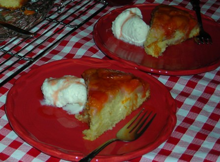 Ready to enjoy Peach Upside Down Cake with a scoop of ice cream.