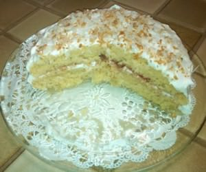 Strawberry Jam Between layers of Coconut Cake