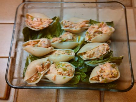 Salmon filled pasta shells on a bed of bok choy