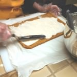 Covering cake with the filling.
