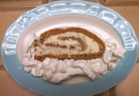 Serving of Pumpkin Roll with Whip Cream